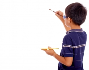 boy painting on blank board