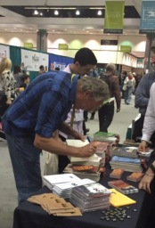 Author James P. Blaylock signing his books at the Bookfair
